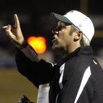 Former Calvary Baptist Academy head coach Doug Pederson yells to his team.