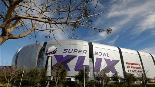 The Super Bowl XLIX logo is displayed on the University of Phoenix Stadium before the Pro Bowl Sunda in Glendale, Ariz. The venue will also host Super Bowl XLIX between the New England Patriots and the Seattle Seahawks Feb. 1.