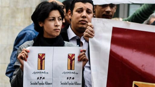 Shaimaa el-Sabbagh, 32,  holds a poster during a protest in downtown Cairo on Jan. 24, 2015. Egypt's chief prosecutor  has referred a police officer to trial in her killing.