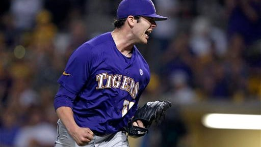LSU pitcher Alex Lange (35) reacts after striking out the last batter in the ninth inning of a game against UNC-Wilmington at the Baton Rouge Regional of the NCAA college baseball tournament in Baton Rouge.