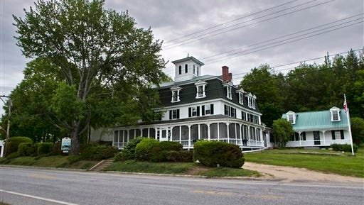 FILE - This June 5, 2015, file photo shows the Center Lovell Inn in Lovell, Maine. Maine State Police said Monday, June 22, 2015, they are investigating whether an innkeeper violated state law in an essay contest with her 210-year-old country inn as the prize.