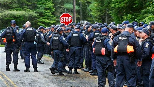 A large group of New York State Department of Corrections and Community Supervision officers gather at the intersection of Mt. View Avenue and County Route 27 in Mountain View, N.Y., Tuesday, June 23, 2015, while searching for two prison escapees from Clinton Correctional Facility. Police began focusing intensely on an area 20 miles west of the prison that inmates David Sweat and Richard Matt escaped from prison on June 6. (Jason Hunter/The Watertown Daily Times via AP)  SYRACUSE OUT