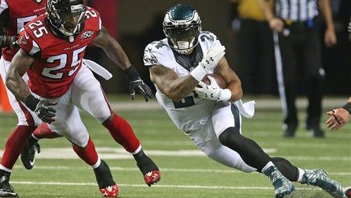 Philadelphia Eagles running back Ryan Mathews (24) runs against Atlanta Falcons strong safety William Moore (25) during the second half of an NFL football game, Monday, Sept. 14, 2015, in Atlanta. (AP Photo/John Bazemore)