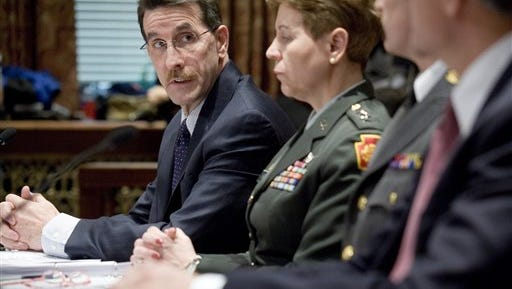 James Joseph, left, the director of the Emergency Management Agency looks toward Adjutant General Jessica Wright of the Department of Military and Veterans Affairs, Thursday, Feb. 22, 2007.