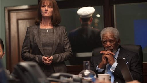 """This image released by Focus Features shows Melissa Leo, left, and Morgan Freeman in a scene from Grammercy Pictures', """"London Has Fallen."""""""