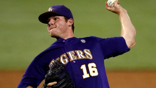 LSU pitcher Jared Poche (16) pitches in the first inning of an NCAA college baseball tournament super regional game against Coastal Carolina in Baton Rouge.