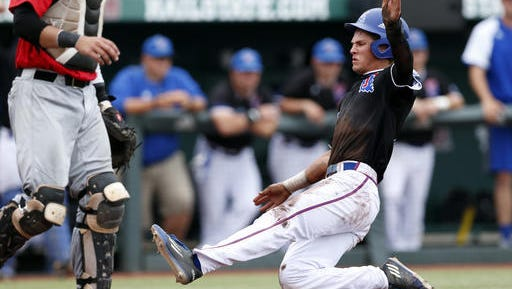Louisiana Tech's Chandler Hall (3) slides safely into home plate during the fourth inning of their NCAA Regional game against Southeast Missouri State at Dudy Noble Field in Starkville, Mississippi Saturday, June 4, 2016.