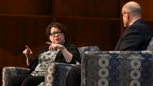 In this Sunday, Aug. 14, 2016 photo, U.S. Supreme Court Associate Justice Sonia Sotomayor answers a question from Robert Hannon during a conversation with her at the University of Alaska, Fairbanks' Davis Concert Hall in Fairbanks, Alaska. (Erin Corneliussen/Fairbanks Daily News-Miner via AP)