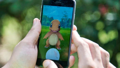 In this Friday, July 22, 2016 file photo, a Pokemon Go player attempts to catch a Charmander character in New Delhi, India. It seems everyone was playing Pokemon Go in 2016.