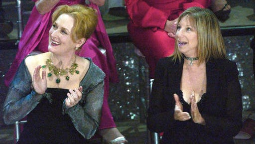 "FILE - In this March 23, 2003, file photo, actresses Meryl Streep, left, and Barbra Streisand applaud on stage during a reunion of past Oscar winners during the 75th Academy Awards in Los Angeles. Streisand told MSNBC ""Hardball"" host Chris Matthews Monday that she completely agrees with Streep's criticisms of Trump during the Golden Globes on Sunday, Jan. 8, 2017. (AP Photo/Kevork Djansezian, File)"