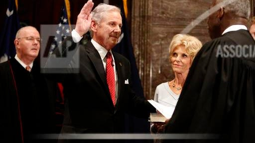South Carolina Governor Henry McMaster, left, is sworn in as by S.C. Chief Justice Don Beatty, right, Tuesday at a ceremonial swearing in at the Statehouse in Columbia, S.C. In the middle is McMaster's wife, Peggy.