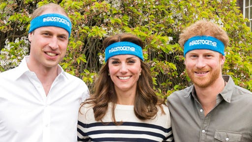 Undated handout  photo of Britain's  Prince William, left, Kate Duchess of Cambridge and Prince Harry wearing charity headbands  issued by The Royal Foundation of the Duke and Duchess of Cambridge and Price Harry. The three royals  are spearheading a campaign to encourage people to talk openly about mental health issues. The young royals released 10 films Thursday as part of their Heads Together campaign to change the national conversation on mental health.
