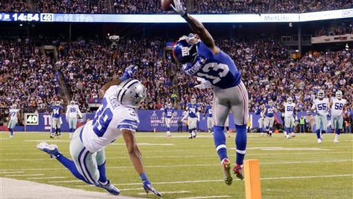New York Giants wide receiver Odell Beckham Jr. (13) makes a one-handed catch for a touchdown against Dallas Cowboys cornerback Brandon Carr (39) in the second quarter of an NFL football game, Sunday in East Rutherford, N.J.