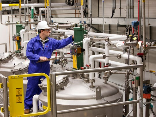 An employee monitors feedstock holding tanks at Virent in Madison.