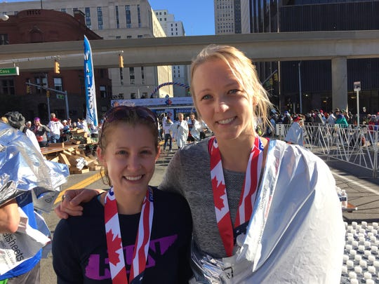 Mary Lambkin, left, and Lizzie Stewart traveled together from Nashville to run Detroit's marathon -- and unexpectedly finished together.