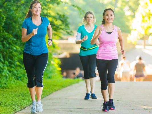 Active seniors power walk in park