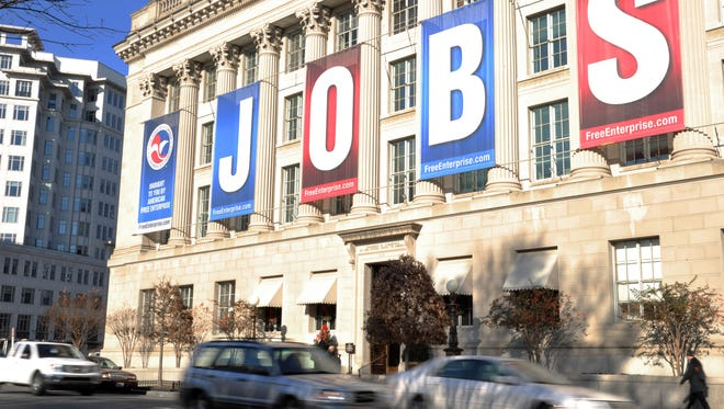 A jobs sign hangs above the entrance to the U.S. Chamber of Commerce building in Washington.