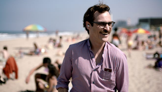 """This image released by Warner Bros. Pictures shows Joaquin Phoenix in a scene from the film, """"Her."""" The film is nominated for a Writers Guild Award."""