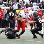 UL defensive lineman Taboris Lee (92), shown here making a tackle in the Appalachian State backfield, was one of the bright spots for the Cajuns in Saturday's 28-7 road loss to Appalachian State.