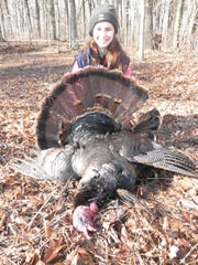 Hannah Riesterer of Valders shows the 22 lb. tom with a 10-inch beard she shot during the 2015 youth turkey hunt. She was hunting near School Hill with her dad, Tad Riesterer.