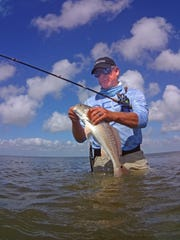 We caught lots of trout and redfish, but not many large