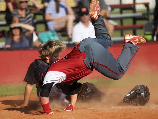 Wakulla Christian's Bailey Newkirk collides with Munroe catcher Jackson Boone.