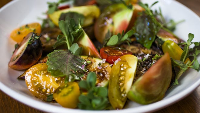 Chef and co-owner Charleen Badman, of FnB Restaurant in Scottsdale, created these beautiful tomato dishes using Neal Brook's tomatoes. This is the tomato salad.