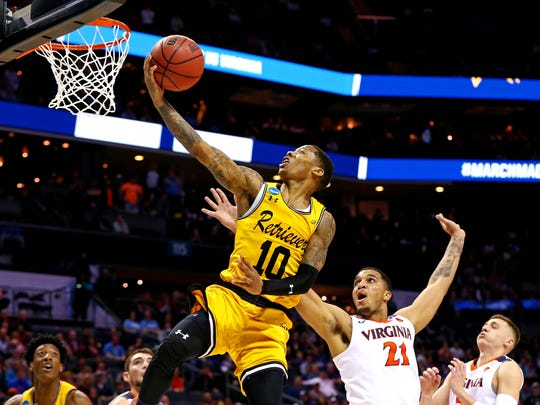 Mar 16, 2018; Charlotte, NC, USA; UMBC Retrievers guard Jairus Lyles (10) shoots the ball against Virginia Cavaliers forward Isaiah Wilkins (21) during the second half in the first round of the 2018 NCAA Tournament at Spectrum Center. Mandatory Credit: Jeremy Brevard-USA TODAY Sports ORG XMIT: USATSI-378327 ORIG FILE ID:  20180316_pjc_bb4_392.JPG