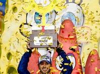NASCAR Sprint Cup Series driver Jimmie Johnson celebrates after winning the Spongebob Squarepants 400 at Kansas Speedway.