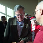 Presidential candidate Jeb Bush signs an autograph in Dubuque, Iowa, on Tuesday