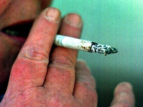 A smoker prepares to inhale in this file photo. The