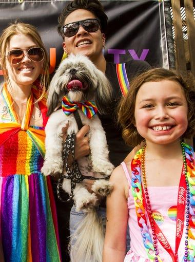 Luis Triujillo, Felisha Gates, Michelle Espinosa and Avinity Triujillo enjoy the Rainbows Festival, presented by Phoenix Pride, on downtown Phoenix on Oct. 18, 2015.