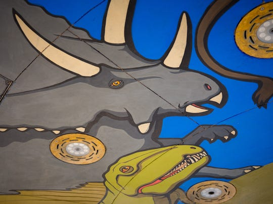 Colorful dinosaurs painted by artist Bob Diven on the base of the splash pad at the new Las Cruces downtown plaza await visitors., The official plaza opening begins with a noon parade on Sept. 17.