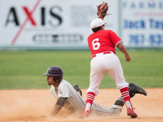 Robstown's Xavier Pena tags out Sinton's Jordan Martinez at second base in the sixth inning of game 3 of the Class 4A regional final series at Steve Chapman Field game on Saturday, June 3, 2017.