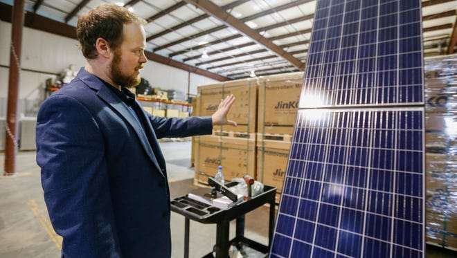 Caleb Arthur, CEO of Sun Solar, talks about solar panels that his company installs for homes and businesses during a tour on Monday, January 23, 2017.
