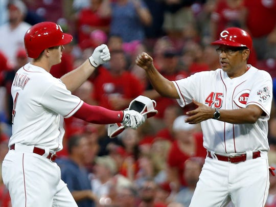 Aug 18, 2018; Cincinnati, OH, USA; Cincinnati Reds left fielder Brandon Dixon (4) reacts with first base coach Freddie Benavides (45) after Dixon hit a two-run double against the San Francisco Giants during the fourth inning at Great American Ball Park. Mandatory Credit: David Kohl-USA TODAY Sports