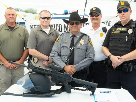 """New Mexico Mounted Patrol of Las Cruces Troop 10 members pictured from left, Chief Jason Holloway, Deputy Chief Kevin Berry, Sgt. Fernando Ravessoud, Capt. Todd Gregory and Lt. Matt Huebert gather for a media day in the parking lot of the Rinconada Walmart on Saturday, July 21, 2018. The group is recruiting for their next academy and wants the public to learn more about them. """"Many people think we are an equestrian or search and rescue unit, said Lt. Matt Huebert,  but actually we are troopers with the full police powers of the agencies we work alongside with, and we can work with any police agency in the state."""""""