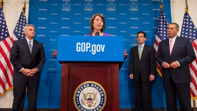 Rep. Cathy McMorris Rodgers, R-Wash., the Republican Conference chair, with, left to right, Rep. Kevin McCarthy, House Majority Leader Eric Cantor and House Speaker John Boehner.