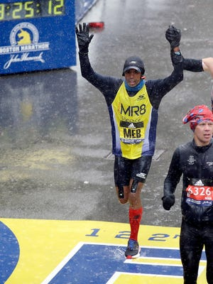Meb Keflezighi, who retired from competitive racing after the 2017 New York Marathon, crosses the finish line in the 122nd Boston Marathon on April 16. He ran on behalf of Team MR8, which raises money for The Martin Richard Foundation.
