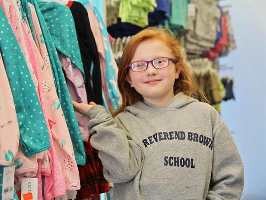 Mary Suggett, 8, of Sparta, with the 150 pairs of pajamas she donated on March 28 to Goryeb Children's Hospital in Morristown.