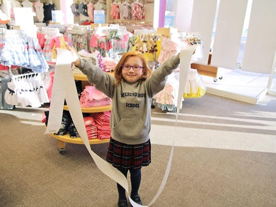 Mary Suggett, 8, of Sparta, with the receipt for 150 pairs of pajamas purchased and donated on March 28 to Goryeb Children's Hospital in Morristown.