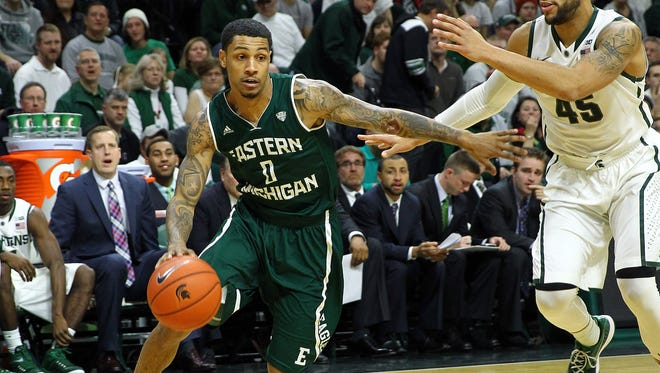 Eastern Michigan Eagles guard Raven Lee (0) drives to the basket against Michigan State Spartans guard Denzel Valentine (45) during the first half of a game at Jack Breslin Student Events Center in December.
