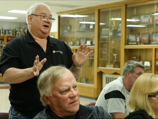 Randy Epting, the complex manager for Hawkeye Pride Egg Farms, answers questions during the school board meeting Tuesday. The egg producer wants to use the building for a biosecurity facility.