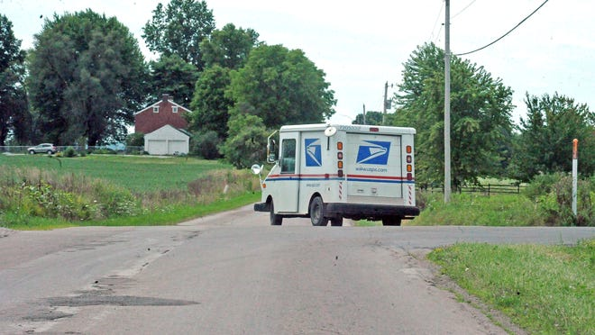 A rural letter carrier makes its daily route in Wayne County delivering letters and packages. Service delays are having an impact on veterans and voters planning to mail in their absentee ballots later this fall.