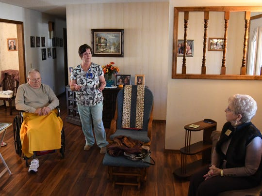 State Rep. Nelda Speaks (far right) visits with (from left) Merilou Rohm, James Schad and Wanda Bollinger on Thursday in the living room of Schad's house in Mountain Home.