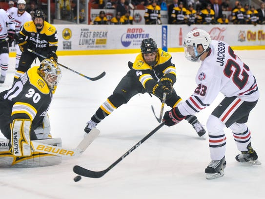 St. Cloud State's Robby Jackson controls the puck near