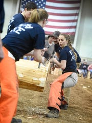 Brooke Killmon, facing camera, and Kayla Knauss compete in the cross-cut competition during the 2017 Farm Show in Harrisburg Saturday, Jan. 14. The demonstration was sponsored by the Sustainable Forestry Initiative Implementation Committee.