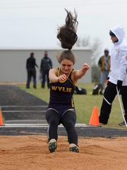 Wylie's Madi Latham prepares to land during the District 5-4A long jump at Wylie on Monday, April 2, 2018. Latham qualified for area with a 14-foot, 10.25-inch jump to place fourth.