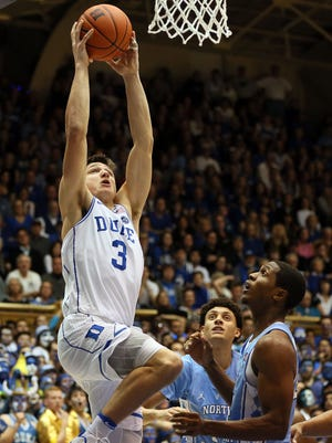 Duke Blue Devils guard Grayson Allen (3) goes up to dunk the ball over North Carolina Tar Heels guard Kenny Williams (24) in the second half of their game at Cameron Indoor Stadium.