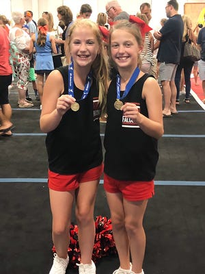 Fairview Middle School's Kaylee Darby (left) and Caroline Coleman were named All American Cheerleaders.